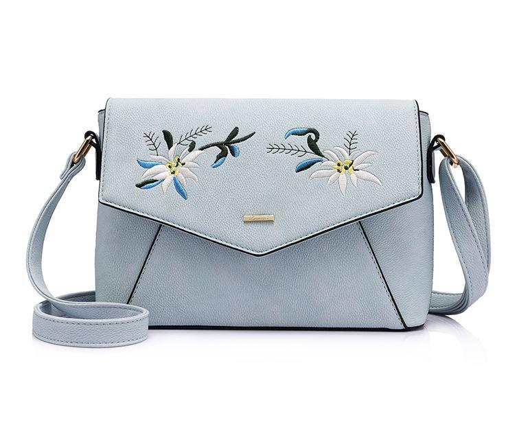 23121a553e Originálna kožená kabelka s vyšívaním v modrej farbe. V tejto kolekcií  nájdete exkluzívne maľby
